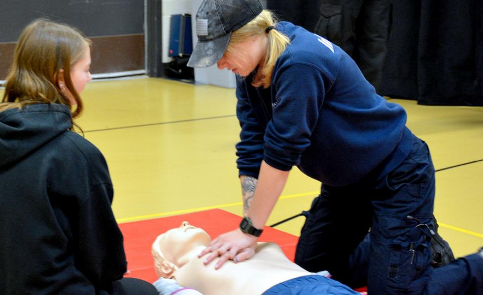 Mid-State Fire Protection Technician graduate and Paramedic Technician student Rachel Zorn demonstrates CPR for attending high school students at the Oct. 22 Program Showcase on Mid-State's Wisconsin Rapids Campus.
