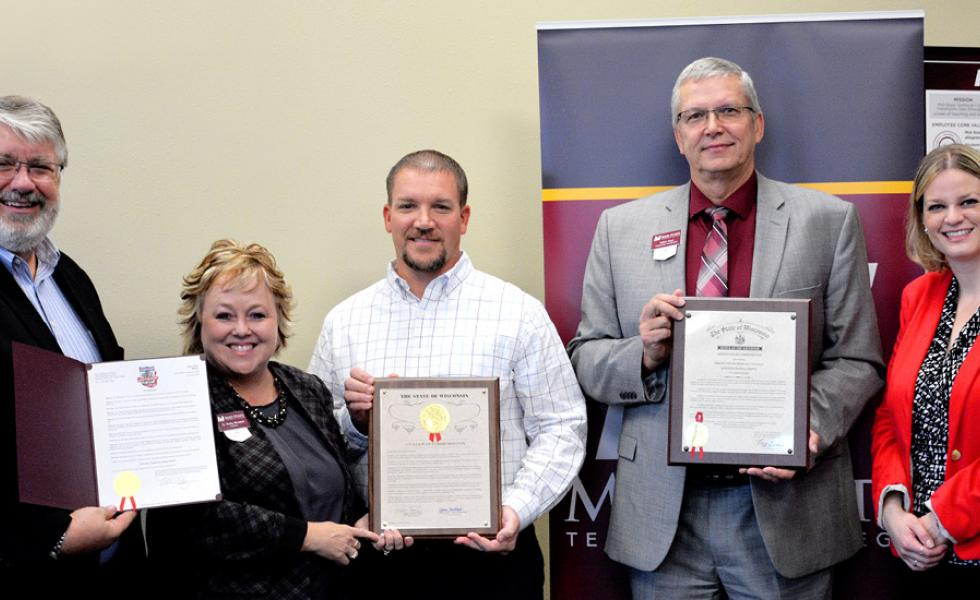 Displaying the Mid-State Month Mayor's Proclamation, Citation of Commendation and Governor's Certificate of Commendation, from left: Stevens Point Mayor Mike Wiza, Mid-State President Dr. Shelly Mondeik, Mid-State Board Member Justin Hoerter, Mid-State Dean of Stevens Point Campus Volker Gaul and State Representative Katrina Shankland.