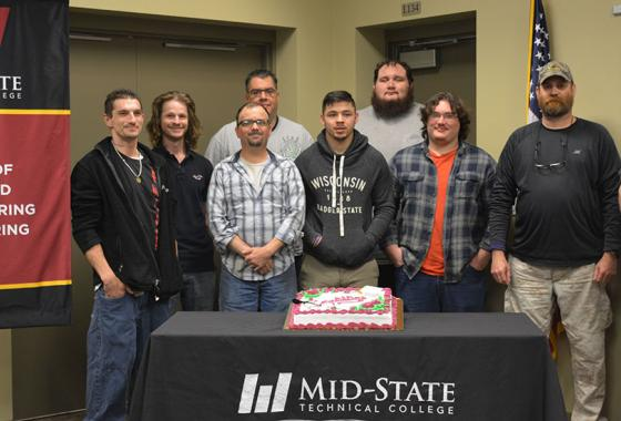 Mid-State Pre-Apprenticeship Machine Tool Training students during their graduation from the program on the Wisconsin Rapids campus, May 23, 2019. From left: Dan Wetzel, Jordan Donahue, Robin Quinnell, Hector Corral, Nick Hibbard, Ethan Thomas, Jarrod Thomas, Lynn Roberts and Tom Watson.
