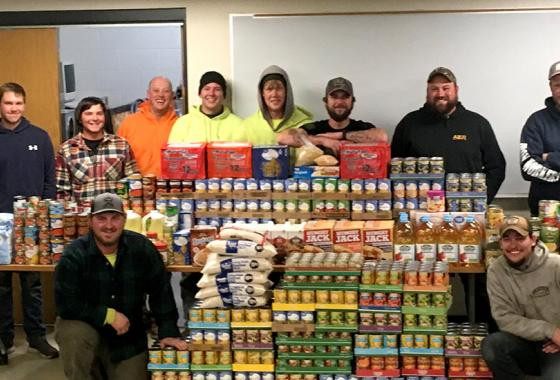 Mid-State's Ironworker apprentices with the 1,624 pounds of food and household items they donated during the College's annual Apprenticeship Food Drive. Over 7,000 pounds in total were donated by Mid-State apprentices.