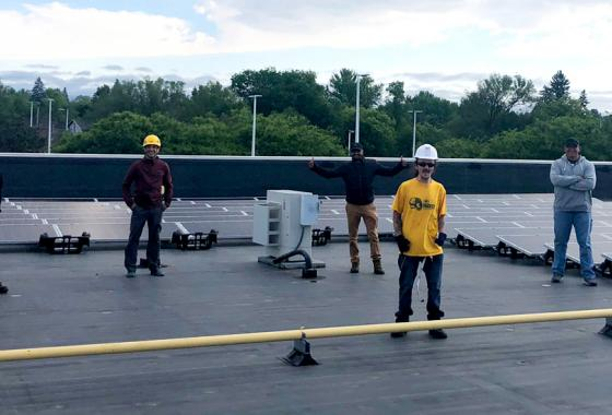 Renewable Energy Technician students strike a socially distanced pose with their recently installed solar panels on the roof of the Stevens Point Campus of Mid-State Technical College this June. The project provided valuable hands-on experience as part of an summer advanced solar installation course.