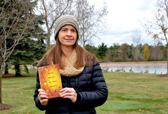 "Mid-State Communication Instructor Jill Sisson Quinn with her recently published nonfiction essay collection ""Sign Here If You Exist."""