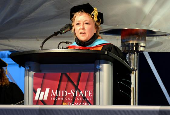 Mid-State Technical College President Dr. Shelly Mondeik addresses graduates attending the College's outdoor graduation ceremonies on the Wisconsin Rapids Campus, Dec. 13.